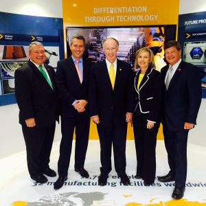 Commerce Secretary Greg Canfield, GKN's Daniele Cagnatel, Gov. Bentley, Elmore County economic developer Leisa Finley, and County Commissioner Joe Faulk at the GKN chalet at the Farnborough Air Show, where the company announced an expansion. (July 15, 2014)