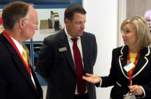 Elmore County economic developer Leisa Finley speaks to Gov. Bentley and GKN's Kasey Myers.