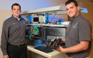 Twins Mark and Eric Becnel with RadioBro satellite radios