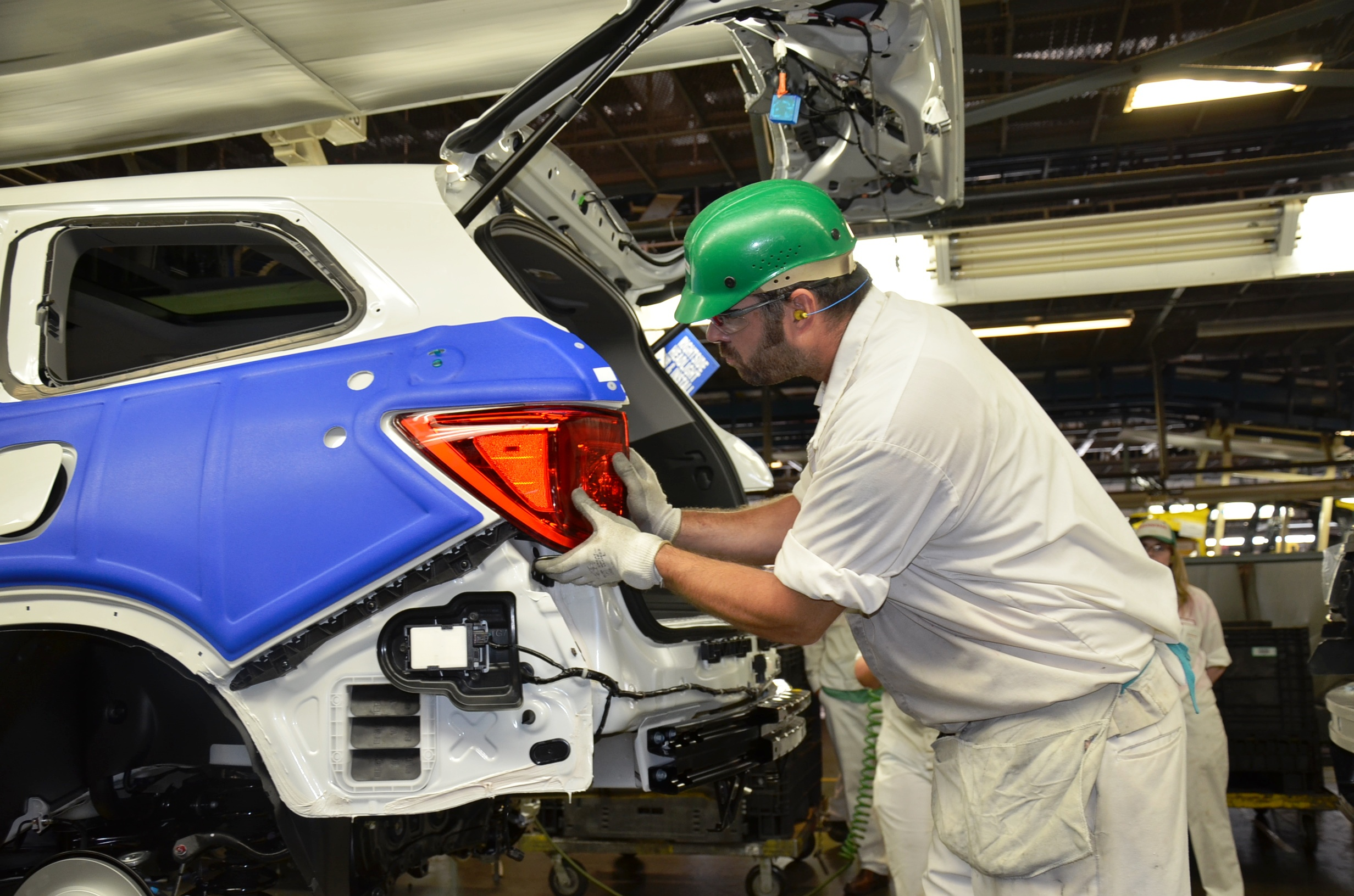A Worker Assembles Pilot SUV At Hondas Plant In Alabama